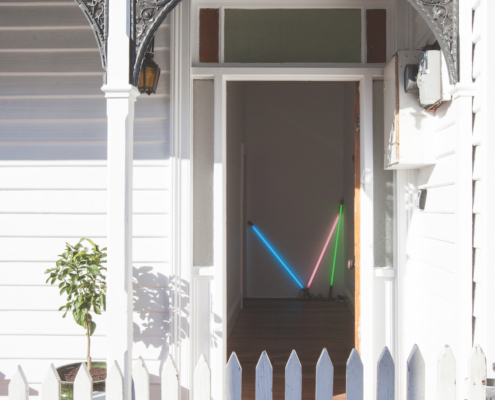 A neon light installation by Zelab and Alessandro Zambelli welcomes guests to the accommodation.